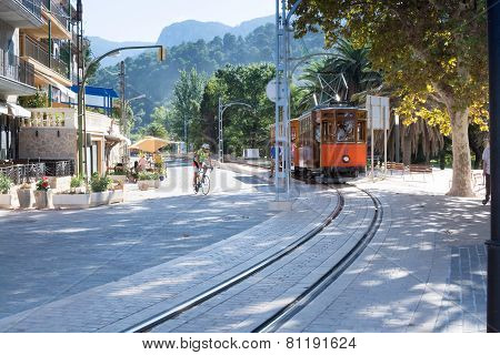 Street View In Port De Soller Mallorca With Tram And Crossing Bicyclist