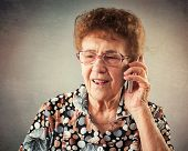 picture of mature adult  - Seniors talking mobile phone - JPG