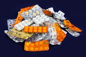 stock photo of blisters  - Tablets and Pills in Blister and Many Empty Pill Blister Packages - JPG