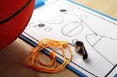 image of basketball  - Scheme basketball game on sheet of paper with basketball on wooden table background - JPG