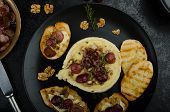 image of brie cheese  - Brie cheese baked with nuts and grapes tasty and crispy baguette and bio herbs reduction of sugar nuts and balsamic vinegar - JPG