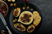 picture of brie cheese  - Brie cheese baked with nuts and grapes tasty and crispy baguette and bio herbs reduction of sugar nuts and balsamic vinegar - JPG