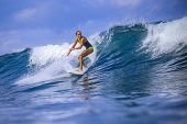 picture of watersports  - Surfer girl on Amazing Blue Wave Bali island - JPG