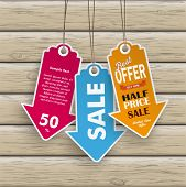 stock photo of arrow  - Infographic with colored price stickers arrow on the wooden background - JPG