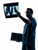 picture of surgeons  - one  man doctor surgeon radiologist medical examining lung torso x - JPG