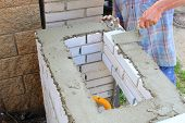 foto of bricklayer  - bricklayer builds a wall - JPG