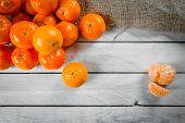 image of satsuma  - Fresh clementine fruits on a wooden table - JPG