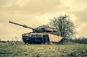 stock photo of panzer  - Russian tank driving around on a field - JPG