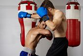 pic of kickboxing  - Two kickbox fighters training in the gym - JPG