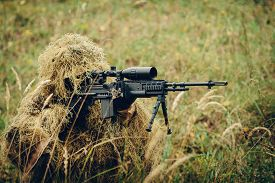 pic of sniper  - sniper in camouflage suit looking at the target - JPG