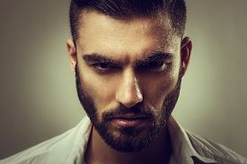 pic of hunk  - Portrait of a man with a beard and wet face - JPG