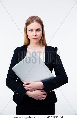 Beautiful businesswoman holding laptop isolated on a white background