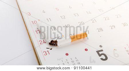 World No Tobacco Day : Broken cigarette on calendar ,sun flare filter effect