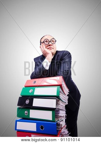 Funny man with lots of folders on white