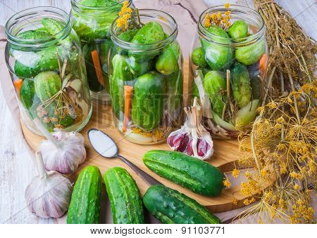 Jars Of Homemade Preserves With Pickled Cucumbers