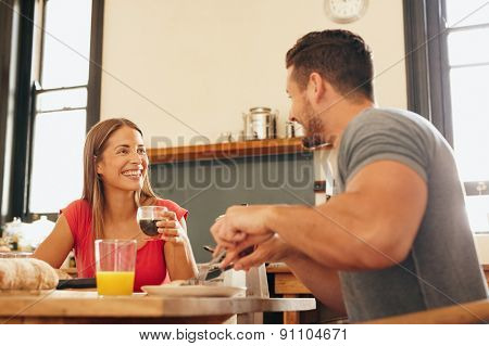 Cheerful Young Couple Having Breakfast Together