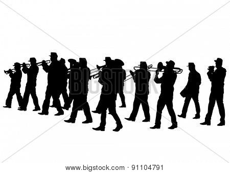 Men walking with a brass instrument