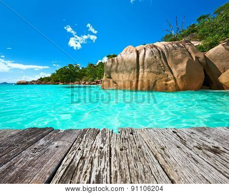 Beautiful beach at Seychelles and old wooden pier, Praslin, Anse Lazio