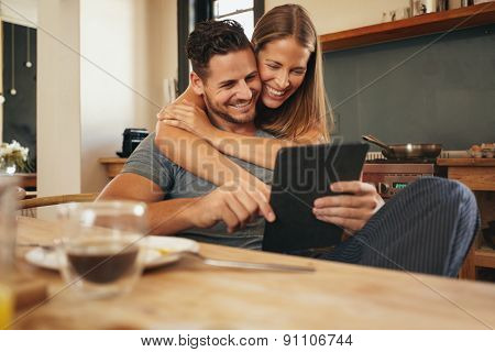 Loving Young Couple Catching Up On Social Media Smiling