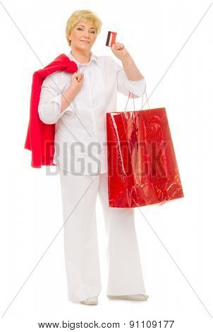 Senior woman with bag and credit card isolated