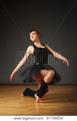 Young ballerina sit on the floor