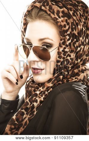 Young woman with leopard pattern scarf and sunglasses, isolated on white