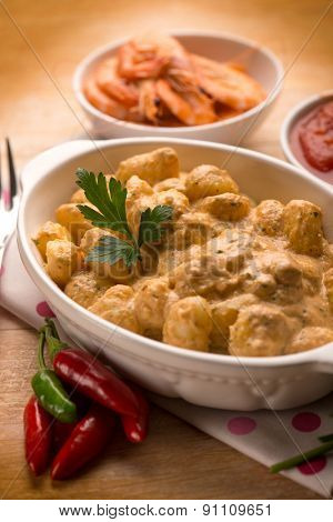 gnocchi with shrimp sauce and tomatoes,  selective focus