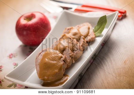tenderloin with apple cream sauce, selective focus