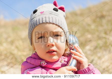 child talking phone, curious, closeup, outdoor communication concept