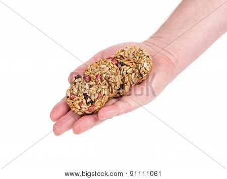 Candied roasted peanuts seeds in hand.