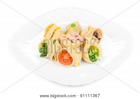 Pasta shells stuffed with vegetables.