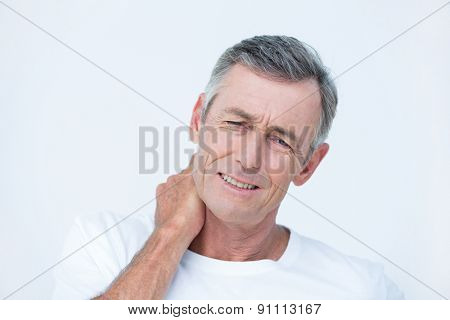 Patient with neck ache in medical office