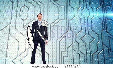Corporate warrior against circuit board on futuristic background