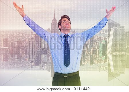 Cheering businessman with his arms raised up against digitally generated server room with towers