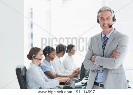 Businessman with executives using computers in office