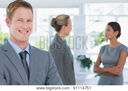 Businessman smiling at camera in the office