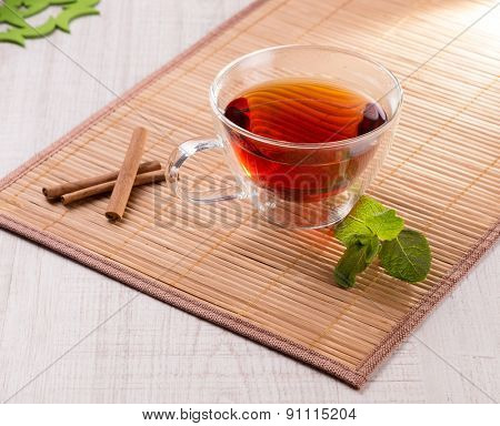 Cup of tea with cinnamon and mint
