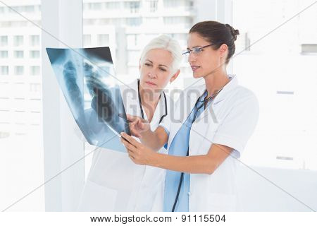female doctors examining x-ray in the medical office