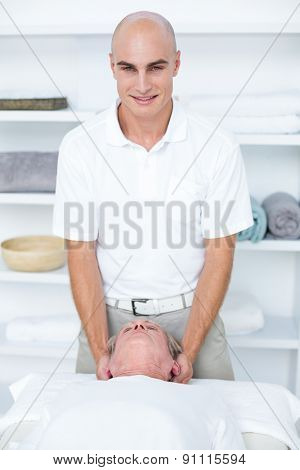 Man receiving head massage in medical office