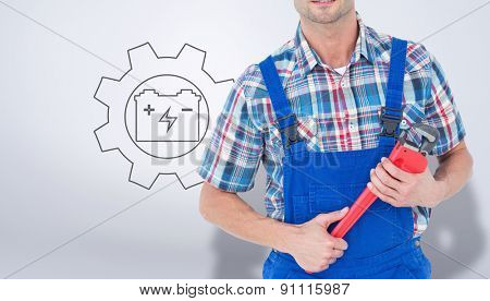 Cropped image of plumber holding monkey wrench against grey vignette