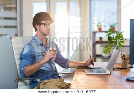 Focused businessman using digitizer in the office