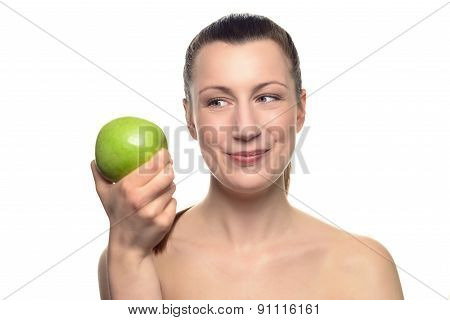 Smiling Woman Looking At Green Apple On Her Hand