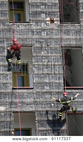 Rescuers During The Workouts Climbing The Building