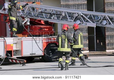 Firefighters During An Emergency With Protective Suits
