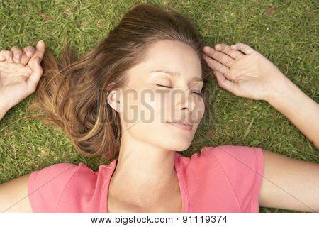 Overhead Of Woman Lying On Grass