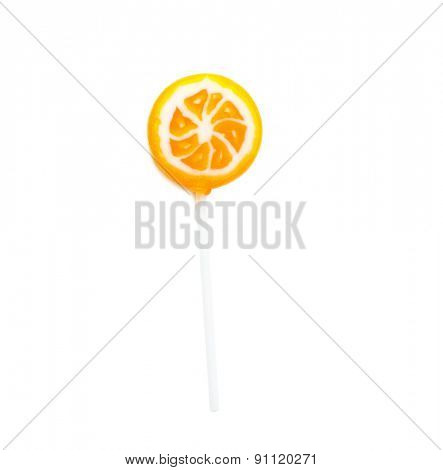 lollipop in the form of orange slices isolated on white background
