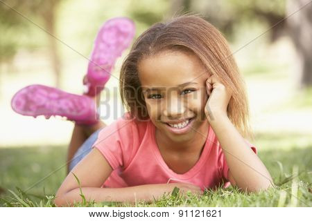 Young Girl Relaxing In Park