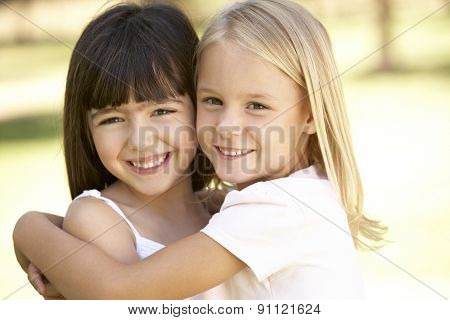2 Young Girls Giving Each Other Hug