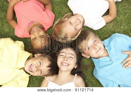 Overhead View Of Group Of Children Smiling At Camera