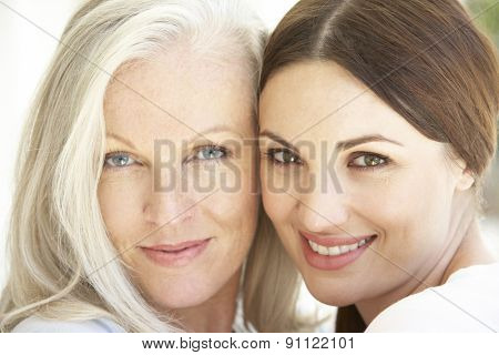 Portrait Of Mature Mother Relaxing With Grown Up Daughter